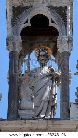 VENICE, ITALY - MAY 28 : Saint Mark the Evangelist, marble statue, detail of the facade of the Saint Mark's Basilica, St. Mark's Square, Venice, Italy, UNESCO World Heritage Sites on May 28, 2017.