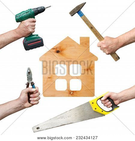 Hands Of Workers With Tool And House