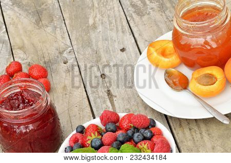 Fruit Bowl With Raspberries, Strawberries, Blueberries, Strawberry, Apricot Jam On A Decorative Plat