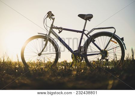 Traveling By Bicycle. Beautiful Scenery With A Bicycle. Sunset On The Lake. Bicycle Silhouette