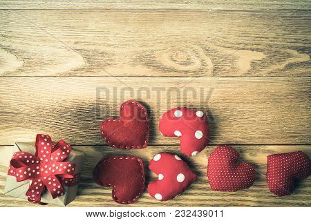 Love Hearts And Gift Box Over Wooden Table Background