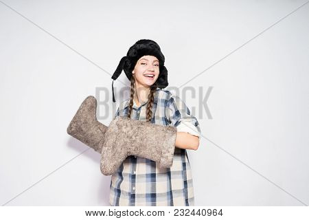 Happy Young Russian Girl In A Black Fur Hat Rejoices In The Winter, Keeps Warm Felt Boots