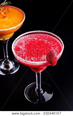 Top View, Two Mango And Strawberry Margarita, Orange And Red Alcoholic Cocktail With Decoration Of S