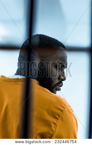 View Of African American Prisoner In Prison Cell
