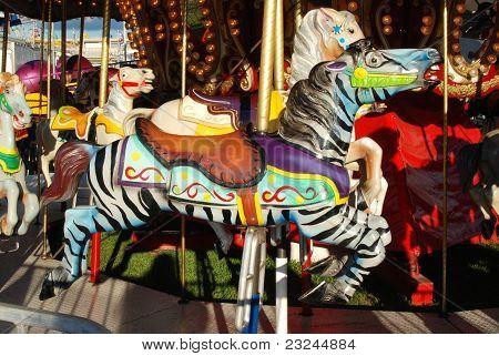 A beautiful rainbow Carousel zebra at a Fair. poster