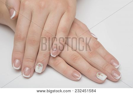 Manicure With Rhinestones In The Shape Of Hearts And Pink Balls On White And Red Nail Polish On A Wh