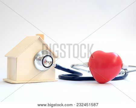 Red Heart Using Stethoscope On The Blue Background For House Health Check. Concept Of Love And Carin