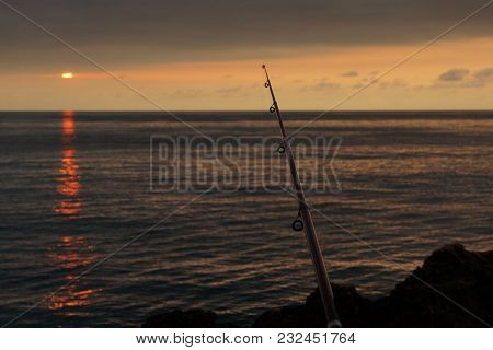 Fishing In The Morning At Dawn On The Sea With A Fishing Rod.