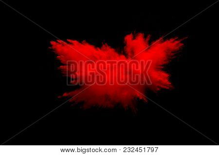 Abstract Explosion Of Red Dust  On  Black Background. Abstract Red Powder Splatter On Dark  Backgrou