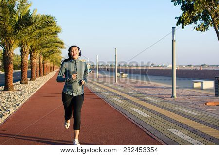Active Girl Jogging On The Running Track, Active Lifestyle