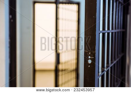 View Of Prison Bars And Empty Prison Cell