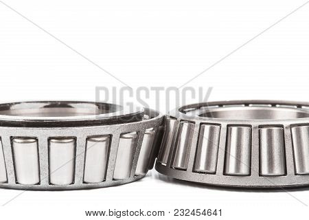 Two Precision Metal Bearings On A White Background. Close Up.