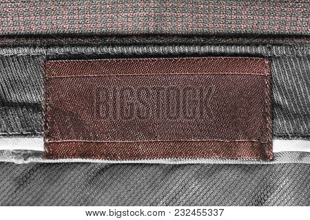 Blank Brown Clothes Label On Textile Background Closeup