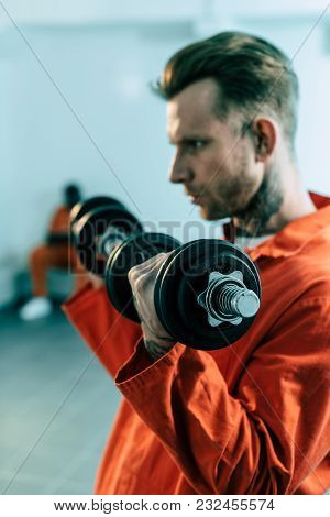 Prisoner Training With Dumbbells In Prison Cell