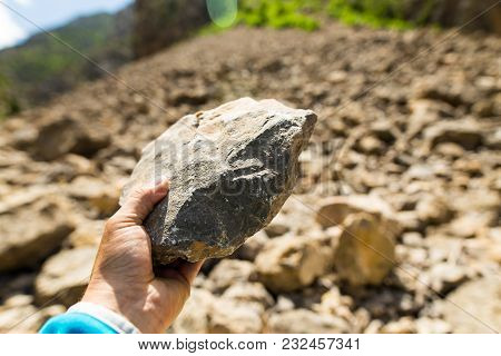 Stone In Hand In Nature In The Mountains