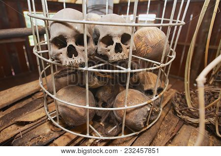 Kuching, Malaysia - August 27, 2009: Human Sculls In The Cage In The Headhouse Of Annah Rais Bidayuh