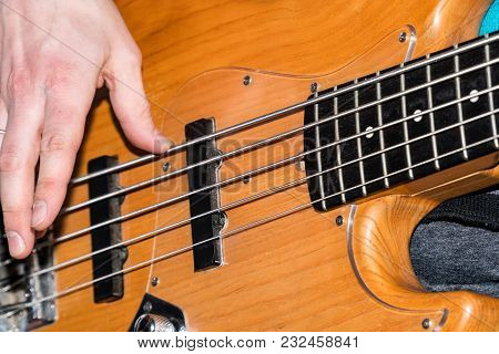 Hands Of The Guitarist's Bass