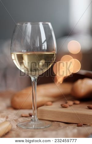 Glass Of White Wine And Cheese, Baguette On The Board