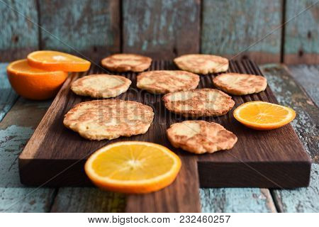 Healthy Vegetarian Sweets. Homemade Cookies With Orange On Oak Board On Shabby Blue Background Persp