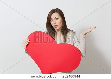 Sad Upset Lamentable Woman Holding Big Red Heart In Hands Isolated On White Background. Copy Space F