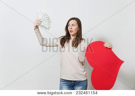 Sad Upset Lamentable Woman Holding Big Red Heart, Bundle Of Cash Money Dollars On White Background.
