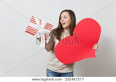 Beautiful Young Smiling Woman Holding Big Red Heart, Box With Present On White Background. Copy Spac