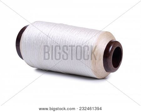 Big thread spools on white background