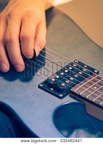 Close Up Of Man Playing On Electric Guitar During Gig Or At Music Studio. Musical Instruments, Passi