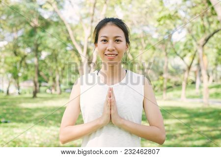 Young Asian Woman Yoga Outdoors Keep Calm And Meditates While Practicing Yoga To Explore The Inner P