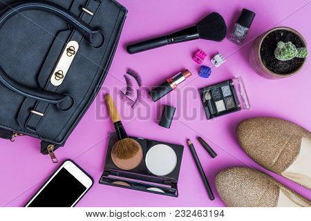 Make Up With Decorative Cosmetics And Smartphone On Pink Background