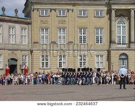 Beautiful View Of Traditional Ceremony Called Changing The Guard. Denmark. Amalienborg Palace, Copen