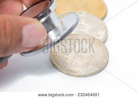 Doctor Hand Hold Stethoscope Check Bitcoin On White Background