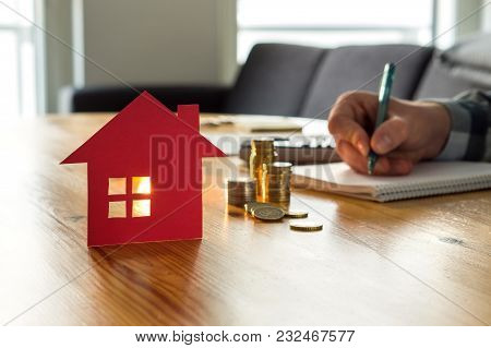 Man Counting House Price, Home Insurance Cost, Property Value Or Rent On Paper. Realtor Or Real Esta
