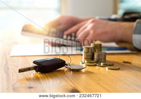 Car Keys And Money On Table With Man Using Calculator. Buyer Counting Savings And Gas Cost Or Salesm