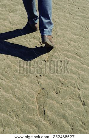 Steps In The Sand. Footprints Left By Footprints In The Sand.