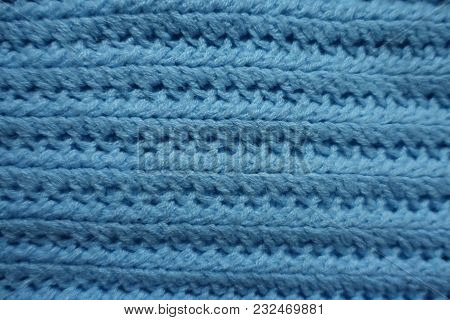 Top View Of Handmade Blue Knitted Fabric With Ribs