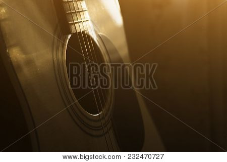 Acoustic Guitar In The Light Of The Sun.