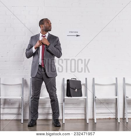 African American Businessman Tying Bow Tie Waiting For Job Interview