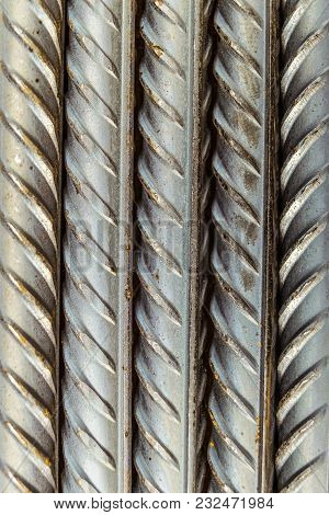 Steel Reinforcing Bars Rods With Periodic Profile, Lying Vertically. Industrial Abstract Background.
