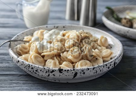 Plate with tasty meat dumplings on table