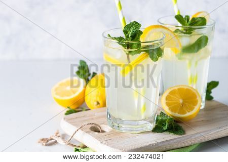 Lemonade. Summer Cold Drink With  Lemon, Mint And Ice. Close Up.