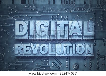 Digital Revolution Phrase Made From Metallic Letterpress Blocks On The Pc Board Background