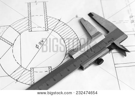 On The Detail Drawing Lies Measuring Tool Vernier Caliper. Black And White Image.