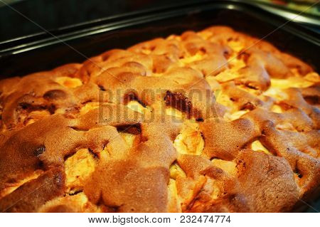 Homemade Apple Pie In The Oven. Delicious Traditional Apple Pie With Cinnamon.