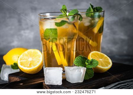 Iced Tea. Summer Cold Drink With Black Tea, Lemon, Mint And Ice.