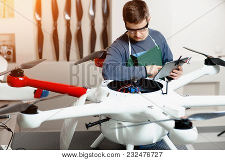 Young Male Engineer Or Technician With Holding Tablet In His Hands Programs Drone