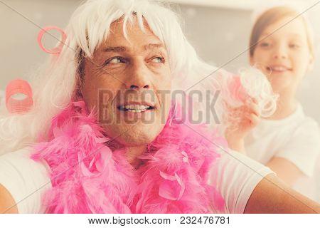 I Need Patience. Nice Thoughtful Patient Man Wearing A Wig And A Feather Boa And Thinking About His