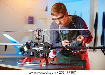 Young Male Engineer Or Technician With Remote Control In His Hands Programs Drone