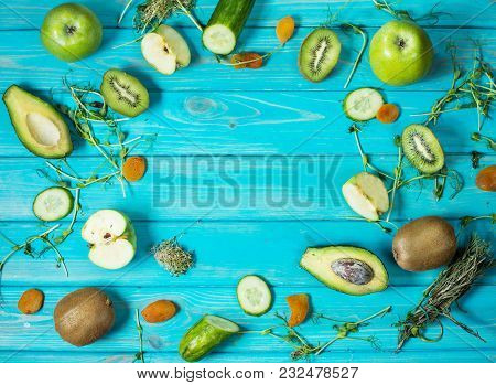 Ingredients For Cooking Smoothie. Organic Green Vegetables And Fruits On Wooden Blue Rustic Backgrou