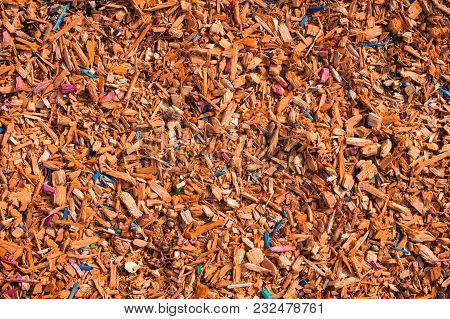Textured Background Decorative Colored Sawdust For Finishing Flowerbeds In The Winter Season. Yellow